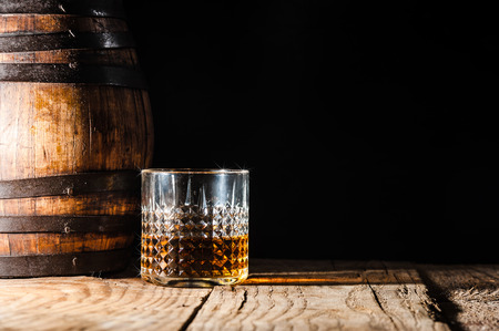 whiskey on a wooden table and barrel