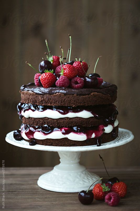Chocolate layer cake with fresh berries by RuthBlack | Stocksy United