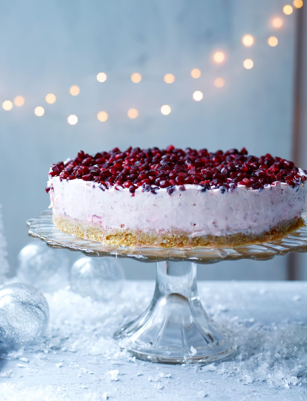 This glamorous pomegranate and raspberry cheesecake is ready to party